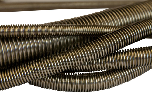 Corrugated tube for transferring liquids and gases where pressures, high and low temperatures, or co